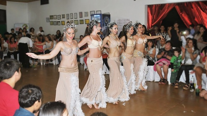 group of belly dancers perform